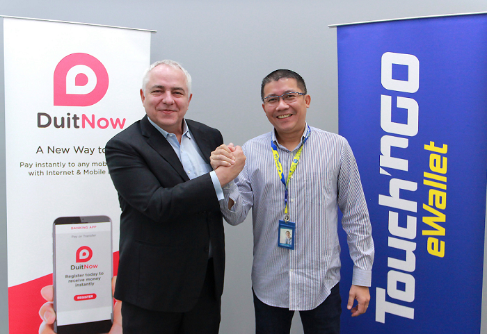 Peter Schiesser of Pay Net and Ignatius Ong of Touch 'n Go.